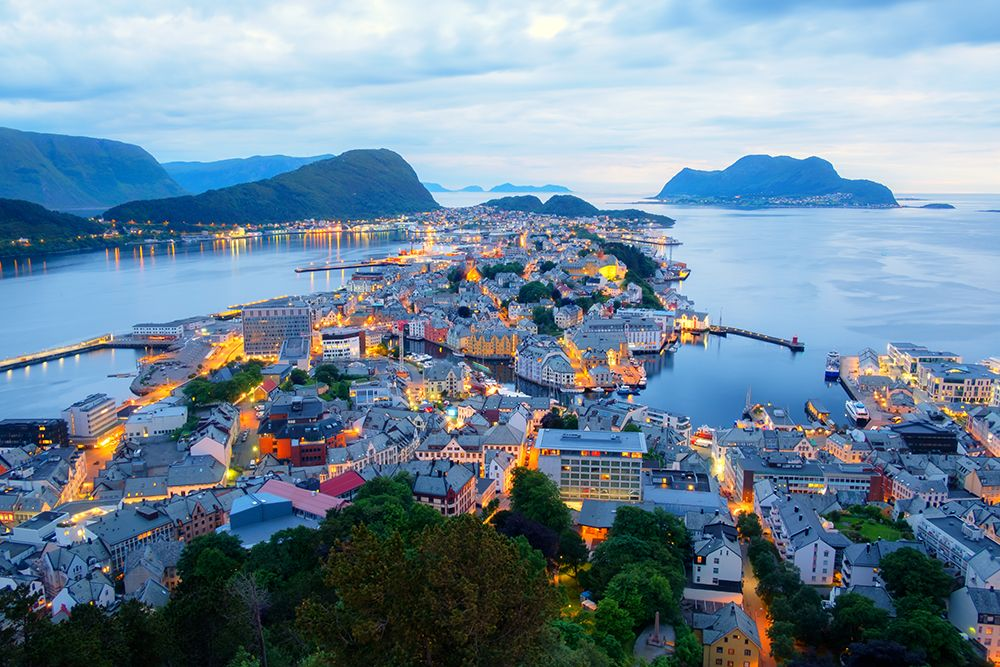 Colorful sunset in Alesund port town on western coast of Norway. Place where the ocean meet the mountains
